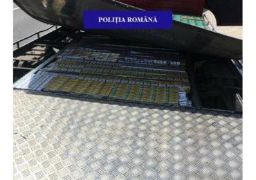 Peste 8.000 de pachete cu tigari nemarcate, descoperite de politistii din Alesd intr-un camion