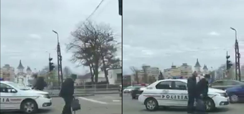 VIDEO! Un politist oradean opreste circulatia pentru a ajuta un batranel sa traverseze strada in siguranta